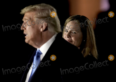 Supremes Photo - United States President Donald J Trump makes remarks as Judge Amy Coney Barrett waits to take the oath of office to be Associate Justice of the Supreme Court outside the Diplomat Room of the White House in Washington DC US October 26 2020 Credit Ken CedenoPool via CNPAdMedia