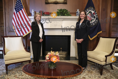 Seal Photo - Amy Coney Barrett US President Donald Trumps nominee for associate justice of the US Supreme Court right meets with Senator Cindy Hyde-Smith a republican from Mississippi at the US Capitol in Washington DC US on Wednesday Sept 30 2020 A bruising Senate confirmation fight over Trumps Supreme Court choice may seal the fates of several incumbent senators in the November election though it has yet to drastically alter the odds for which party will control the chamber (Photo by Oliver ContrerasBloomberg)Credit Oliver Contreras  Pool via CNPAdMedia