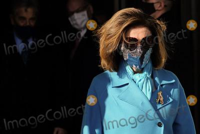 Nancy Pelosi Photo - WASHINGTON DC - JANUARY 20 House Speaker Nancy Pelosi D-Calif arrives at the US Capitol ahead of the inauguration of President Joe Biden on January 20 2021 in Washington DC (Photo by Melina MaraThe Washington PostPOOL)AdMedia
