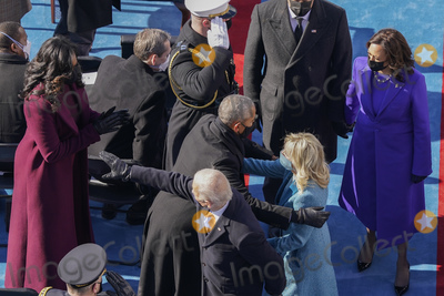 Michelle Obama Photo - President Joe Biden and first lady Jill Biden with former President Barack Obama and Michelle Obama as they leave the stage at the 59th Presidential Inauguration at the US Capitol in Washington Wednesday Jan 20 2021 Walking behind Biden is Vice President Kamala Harris and her husband Doug Emhoff (AP PhotoSusan Walsh Pool)AdMedia