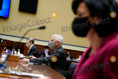 The National Photo - Dr Anthony Fauci Director of the National Institute of Allergy and Infectious Diseases at the National Institutes of Health prepares to testify before the US House Select Subcommittee on the Coronavirus Crisis holds a hearing on the Capitol Hill in Washington on Thursday April 15 2021 Credit Amr Alfiky  Pool via CNPAdMedia