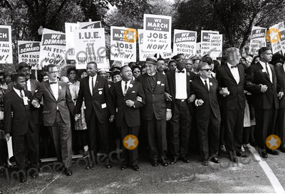 Martin Luther King Photo - Reverend Dr Martin Luther King Jr 4th from left and other civil rights leaders hold hands as they lead a crowd of hundreds of thousands at the March on Washington for Jobs and Freedom Washington DC August 28 1963 from left to right John Lewis Mathew Ahmann unidentified Dr King unidentified unidentified Rabbi Joachim Prinz unidentified and Whitney YoungCredit Arnie Sachs  CNPAdMedia