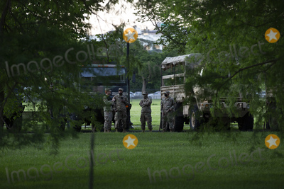 The National Photo - Members of the National Guard look on at protestors gather outside the White House in Washington DC US on Sunday May 31 2020 following the death of an unarmed black man at the hands of Minnesota police on May 25 2020  Credit Stefani Reynolds  CNPAdMedia
