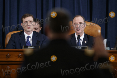 Alexander Vindman Photo - Democratic Chairman of the House Permanent Select Committee on Intelligence Adam Schiff (R) and Democratic legal counsel Daniel Goldman (L) as Director for European Affairs of the National Security Council US Army Lieutenant Colonel Alexander Vindman is sworn in during the House Permanent Select Committee on Intelligence public hearing on the impeachment inquiry into US President Donald J Trump on Capitol Hill in Washington DC USA 19 November 2019 The impeachment inquiry is being led by three congressional committees and was launched following a whistleblowers complaint that alleges US President Donald J Trump requested help from the President of Ukraine to investigate a political rival Joe Biden and his son Hunter BidenCredit Shawn Thew  Pool via CNPAdMedia