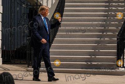 White House Photo - United States President Donald J Trump walks to Marine One on the South Lawn of the White House on Thursday October 15 2020 Trump will deliver remarks at a Fundraising Committee Reception in Doral FLand participate in a Live NBC News Town Hall Event   Credit Ken Cedeno  Pool via CNP