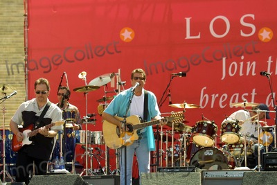 Glenn Frey Photo - Glenn Frey and his band perform at the 11th Annual Revlon RunWalk For Women to support breast and ovarian cancer research awareness and prevention programs Los Angeles Memorial Coliseum Los Angeles CA 05-08-04