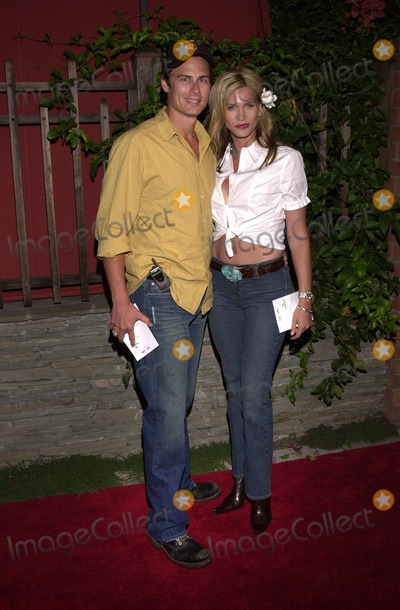 Liam Waite Photo - Natasha Henstridge and Liam Waite at the launch party for Eastwood Ranchs new lifestyle brand with Denim Tapas and Tequila held at Chadwick Beverly Hills CA 07-16-02