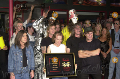 Cliff Williams Photo -  Cliff Williams Brian Johnson Angus Young Malcolm Young at the ceremony where they were inducted into Sunset Blvds Rockwalk 09-15-00