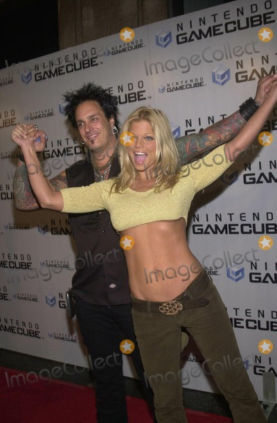 Nikki Sixx Photo -  NIKKI SIXX and DONNA DERRICO at the launch party for the new Nintendo Game Cube system sponsored by MTV in Hollywood 10-03-01