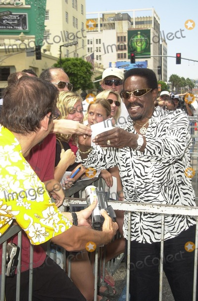 Ike Turner Photo - Ike Turner signs autographs for fans at Singletons induction into the Hollywood Walk of Fame Hollywood CA 08-26-03