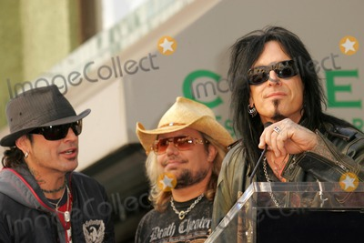 Motley Crue Photo - Motley Crueat the ceremony honoring them with the 2301st star on the Hollywood Walk of Fame Hollywood Boulevard CA 01-25-06