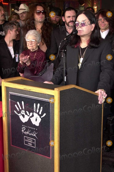 Randy Rhoads Photo - Ozzy Osbourne speaks as Randy Rhoads family and friends watch at the ceremony posthumously inducting guitarist Randy Rhodes into Hollywoods Rockwalk on Sunset Boulevard Hollywood CA 03-18-04