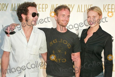 Danny Masterson Photo - Danny Masterson Chris Masterson and Laura Prepon at the Celebrity Poker Night at Esquire House Beverly Hills CA 09-16-04