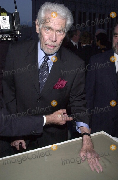 James Coburn Photo - James Coburn gets his handprints in cement at the first annual Stella Adler awards Highlands Nightclub Hollywood 06-01-02