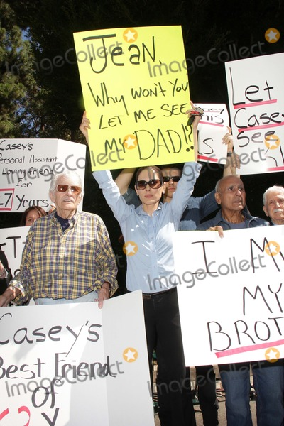 Casey Kasem Photo - Charles Olsen Kerri Kasem Jesse Kove Mouner Kasemat a protest involving Casey Kasems children brother and friends who want to see him but have been denied any contact  Private Location Holmby Hills CA 10-01-13