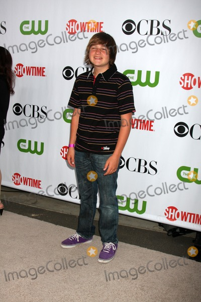 Angus T Jones Photo - Angus T Jones arriving at the CBS Television Distribution TCA Stars Party at the Huntington Library in San Marino CA  on August 3 2009