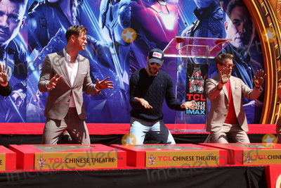 CAST MEMBER Photo - LOS ANGELES - APR 23  Chris Hemsworth Chris Evans Robert Downey Jr at the Avengers Cast Members Handprint Ceremony at the TCL Chinese Theater on April 23 2019 in Los Angeles CA