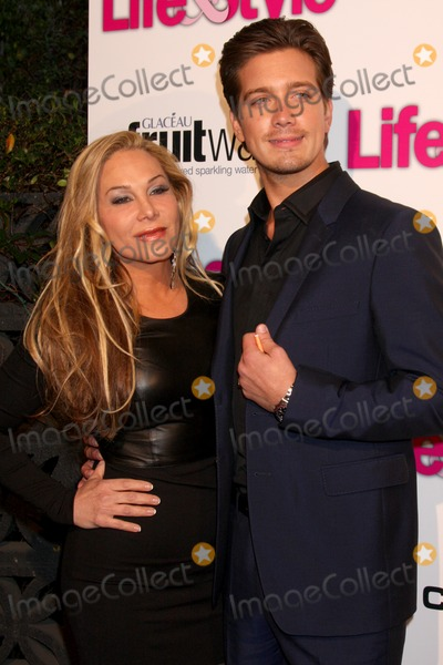 Adrienne Maloof Photo - LOS ANGELES - OCT 9  Adrienne Maloof Jacob Busch at the Hollywood In Bright Pink at Bagatelle LA on October 9 2013 in West Hollywood CA