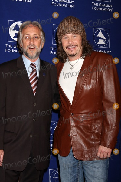 Neil Portnow Photo - Neil Portnow  George Flaningenarriving at the cue the Music A celebration of Music and Television - The Grammy Foundations 12th Annual Music Preservation ProjectWilshire Ebell TheaterLos Angeles CAJanuary 28 2010