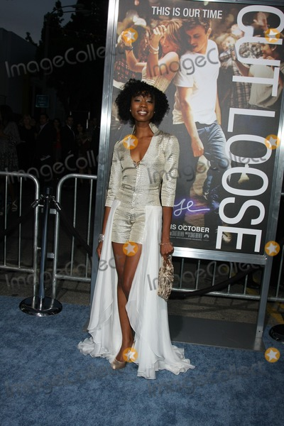 Enisha Brewster Photo - LOS ANGELES - OCT 3  Enisha Brewster arriving at the Footloose Premiere at the Regency Village Theater on October 3 2011 in Westwood CA