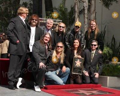 Roy Orbison Photo - Barbara Orbison (2nd R) wife of late singer Roy Orbison and his sons Wesley (L) Alex (2nd L) and Roy Orbison Jr (R) with freinds TB Bennett Dan Akroyd othersHollywood Walk of Fame Star Ceremony for Roy Orbison Capitol Records buildingLos Angeles CAJanuary 29 20102010 Kathy Hutchins  Hutchins Photo