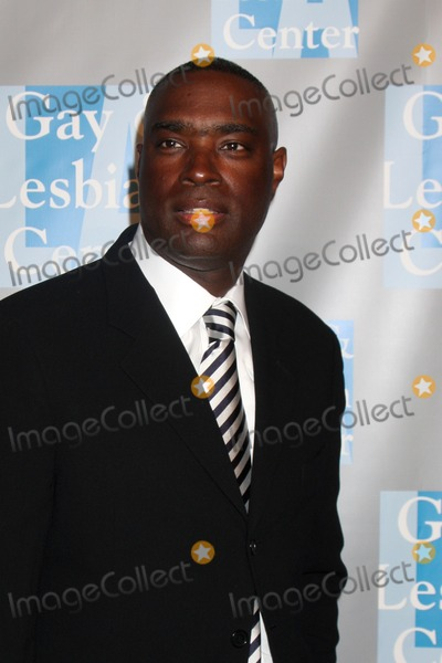 Antwone Fisher Photo - Antwone Fisher with guest arriving at the Gay  Lesbian Center An Evening With Women Gala at the Beverly Hilton Hotel in Beverly Hills California on April 24 2009
