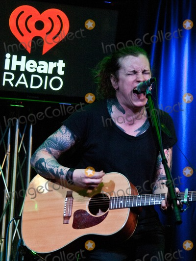 Against Me Photo - BALA CYNWYD PA - MAY 06 Laura Jane Grace of American Alternative Rock Band Against Me Performs at Radio 1045s Performance Theatre on May 06 2014 in Bala Cynwyd Pennsylvania (Photo by Paul J FroggattFamousPix)