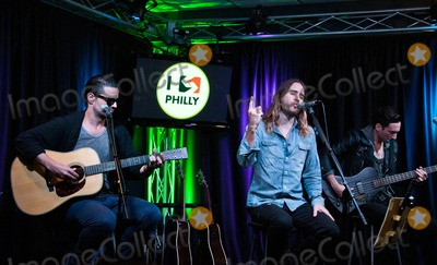 Tomo Milicevic Photo - BALA CYNWYD PA - SEPTEMBER 29 (L to R) Tomo Milicevic Jared Leto and Stephen Aiello of American Alternative Rock Band Thirty Seconds To Mars Perform at Radio 1045s Performance Theatre on September 29 2013 in Bala Cynwyd Pennsylvania (Photo by Paul J FroggattFamousPix)