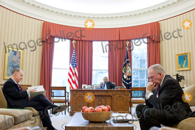 John Brennan Photo - National Security Advisor Tom Donilon and John Brennan Assistant to the President for Homeland Security and Counterterrorism right listen as United States President Barack Obama talks on the phone in the Oval Office March 16 2011 Photo by Pete SouzaWhite HouseCNP-PHOTOlinknet