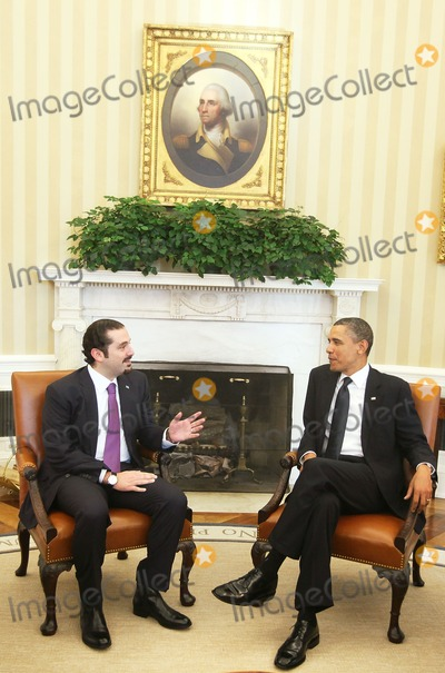 Alex Wong Photo - United States President Barack Obama (R) meets with Prime Minister Saad Hariri (L) of Lebanon in the Oval Office of the White House Wednesday January 12 2011 in Washington DC  According to a White House media release the two leaders met to discuss US support for Lebanons sovereignty independence and stability the ongoing work of the Special Tribunal for Lebanon and other regional issues Photo by Alex Wong PoolCNP-PHOTOlinknet