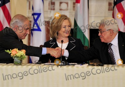 Benjamin Netanyahu Photo - United States Secretary of State Hillary Rodham Clinton center smiles as Prime Minister Benjamin Netanyahu of Israel left and Mahmoud Abbas of the Palestinian Authority shake hands following their remarks at the start of the Relaunch of Direct Negotiations Between the Israelis and Palestinians in the Benjamin Franklin Room of the US Department of State on Thursday September 2 2010  Credit Ron Sachs  CNP(RESTRICTION NO New York or New Jersey Newspapers or newspapers within a 75 mile radius of New York City)