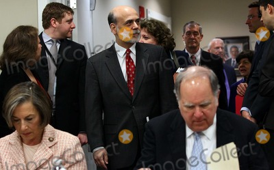 AN ATTENDEE Photo - Federal Reserve Chairman Ben Bernanke gets a pat on the back from an attendee of the National Commission on Fiscal Responsibility and Reform before remarks Tuesday April 27 2010 in Washington DC Topics of the meeting were to include the nations long-term fiscal challenges defining the scope of the commissions work and its internal operating structure and identifying what subcommittees should be formed to support its work Photo by Win McNameePool-CNP-PHOTOlinknet