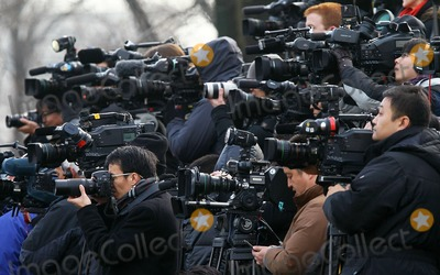 Alex Wong Photo - WASHINGTON DC - JANUARY 19 (AFP OUT) Members of the media cover the state arrival ceremony for Chinese President Hu Jintao at the South Lawn of the White House January 19 2011 in Washington DC Hu and President Obama will hold a press conference at the White House later today  Photo by  Alex WongPoolCNP-PHOTOlinknet