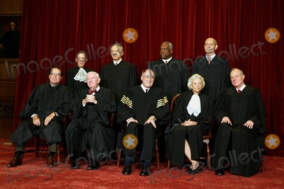 Antonin Scalia Photo - The justices of the United States Supreme Court gather for a group portrait at the Supreme Court Building in Washington DC on  December 5 2003  Traditionally the justices pose for a group portrait only when there is a change  The court has not changed in nine years  Left to right in front row are Associate Justice Antonin Scalia Associate Justice John Paul Stevens  Chief Justice of the United States William Hubbs Rehnquist  Associate Justice Sandra Day OConnor  and Associate Justice Anthony M Kennedy Back row from left are Associate Justice Ruth Bader Ginsburg  Associate Justice David Hackett Souter  Associate Justice Clarence Thomas  and Associate Justice Stephen Breyer