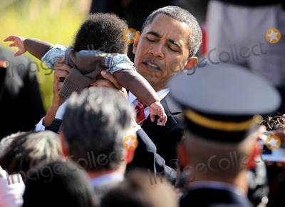 Tragedie Photo - United States President Barack Obama holds up a baby as he greets victims families during an event to mark the anniversary of the 911 terrorist attacks at the Pentagon Memorial Saturday September 11 2010 in Arlington Virginia Obama delivered remarks and laid a wreath during the event on the 9th anniversary of the tragedy  Photo by Alex WongPoolCNP-PHOTOlinknet