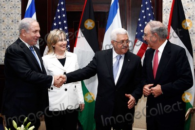 Mahmoud Abbas Photo - Prime Minister Benjamin Netanyahu of Israel(first from left) United States Secretary of State Hillary Rodham Clinton (second from left) President Mahmoud Abbas of the Palestinian Authority (third from left) and US Special Envoy for Middle East Peace George C Mitchell (fourth from left) chat after their meeting in Sharm El Sheikh Egypt on Tuesday September 14 2010Photo by Department of StateCNP-PHOTOlinknet