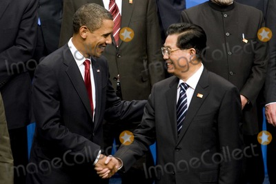 Hu Jintao Photo - Pittsburgh PA - September 25 2009 -- United States President Barack Obama left greets Hu Jintao president of China before a Group of 20 nations family photo on day two of the G-20 summit in Pittsburgh Pennsylvania US on Friday September 25 2009 G-20 leaders are working on an accord to prevent a repeat of the worst global financial crisis since the Great Depression and ensure a sustained recovery  Photo By Andrew HarrerPool-CNP-PHOTOlinknet