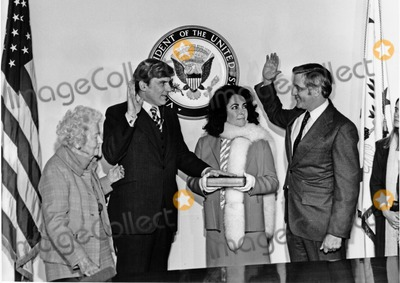The Ceremonies Photo - United States Senator John W Warner (Republican of Virginia) left center is sworn-in by US Vice President Walter Mondale right  Looking on is Warners wife Actress Elizabeth Taylor right center and Senator Warners mother Mrs Martha Warner right look on in Washington DC on January 15 1979  The ceremony followed Senator Warners official swearing-in in the US Senate ChamberPhoto by US Senator Warners OfficeCNP-PHOTOlinknet