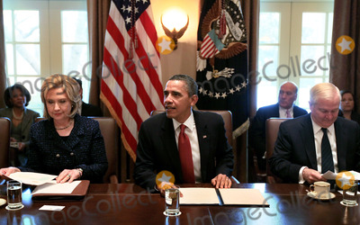 Mark Wilson Photo - United States President Barack Obama (C) US Secretary of State of State Hillary Clinton (L) and US Secretery of Defense Robert Gates participate in a cabinet meeting at the White House Wednesday February 1 2011 in Washington DC Later in the day President Obama will meet with members of the Technology CEO Council to discuss competitiveness innovation and the need to create jobs  Photo by Mark Wilson PoolCNP-PHOTOlinknet
