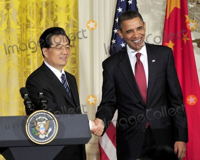 President Hu Jintao Photo - RESTRICTED NEW YORKNEW JERSEY OUTNO NEW YORK OR NEW JERSEY NEWSPAPERS WITHIN A 75 MILE RADIUS OF NYCUnited States President Barack Obama and President Hu Jintao of China shake hands following a joint press conference in the East Room of the White House during the State Visit honoring President Hu on Wednesday January 19 2011 Photo by Ron Sachs-CNP-PHOTOlinknet