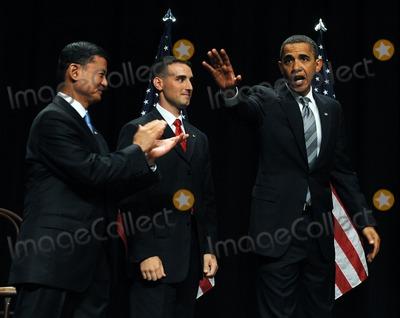 Eric Shinseki Photo - Fairfax VA - August 3 2009 -- United States President Barack Obama waves after speaking during an event to mark the implementation of the Post-911 GI Bill at George Mason University in Fairfax Virginia on Monday August 3 2009 With him are US Secretary of Veterans Affairs General Eric Shinseki left and Marine Corps Staff Sergeant James Miller  Photo by Roger WallenbergPOOL-CNP-PHOTOlinknet