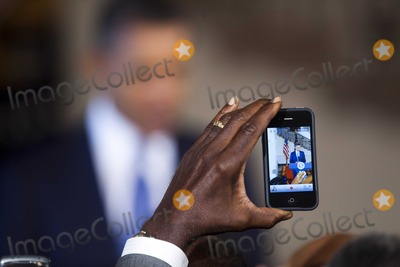 AN ATTENDEE Photo - United States President Barack Obama is videoed by an attendee with an Iphone as he delivers remarks at the Historically Blacks Colleges and Universities reception in the Grand Foyer of the White House in Washington DC on Monday 13 September 2010Photo by Jim Lo ScalzoPoolCNP-PHOTOlinknet