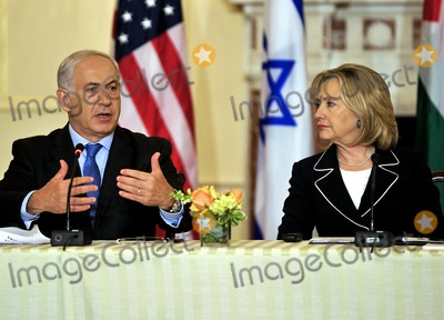 Benjamin Netanyahu Photo - Prime Minister Benjamin Netanyahu of Israel makes remarks as United States Secretary of State Hillary Rodham Clinton listens at the Relaunch of Direct Negotiations Between the Israelis and Palestinians in the Benjamin Franklin Room of the US Department of State on Thursday September 2 2010  Credit Ron Sachs  CNP(RESTRICTION NO New York or New Jersey Newspapers or newspapers within a 75 mile radius of New York City)
