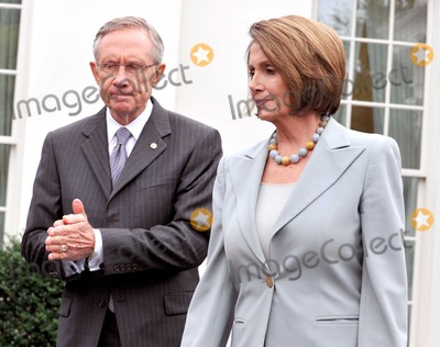 Harry Reid Photo - Washington DC - October 6 2009 -- United States Senate Majority Leader Harry Reid (Democrat of Nevada) left and US Speaker of the House Nancy Pelosi right make their way to the microphones to make remarks after meeting United States President Barack Obama on the US strategy in Afghanistan on Tuesday October 6 2009Digital Photo by Ron SachsPool-CNP-PHOTOlinknet
