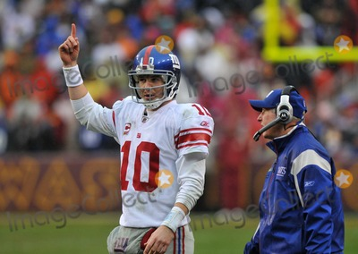 Tom Coughlin Photo - RESTRICTED NO NEW YORK OR NEW JERSEY NEWSPAPERS WITHIN A 75 MILE RADIUS OF NYCLandover MD - November 30 2008 -- New York Giants quarterback Eli Manning (10) points skyward as he listens to head coach Tom Coughlins instructions late in the second quarter against the Washington Redskins at FedEx Field Photo by Ron Sachs-CNP-PHOTOlinknet