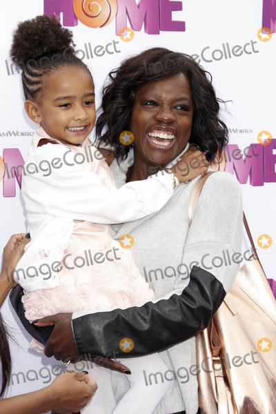 Genesis Photo - Photo by REWestcomstarmaxinccomSTAR MAX2015ALL RIGHTS RESERVEDTelephoneFax (212) 995-119632215Viola Davis and daughter Genesis at The Premiere of Home(Los Angeles CA)