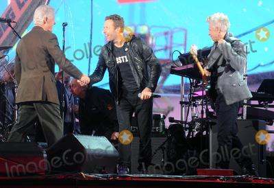 Adam Clayton Photo - Photo by Dennis Van TinestarmaxinccomSTAR MAX2014ALL RIGHTS RESERVEDTelephoneFax (212) 995-119612114Bill Clinton Chris Martin and Adam Clayton at a free benefit concert honoring World AIDS Day(Times Square)