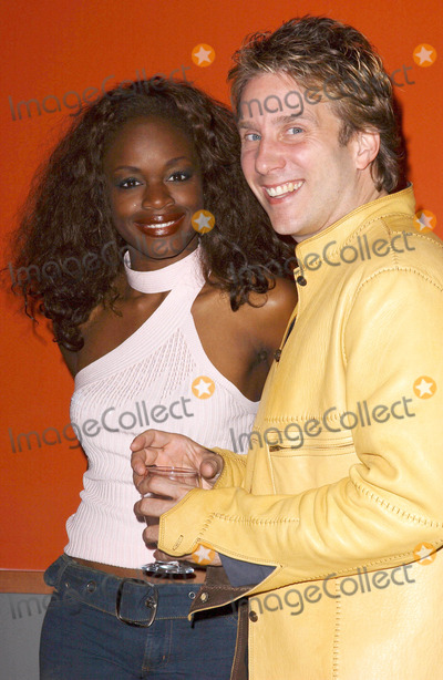 John Livesay Photo - Photo by Lee Rothstarmaxinccom200441304Nzinga Blake and John Livesay at the pre-release listening party for Every Little Seam(West Hollywood CA)