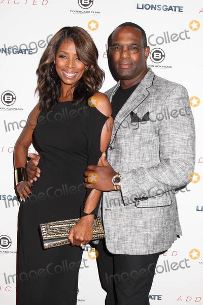 Tasha Smith Photo - Photo by HQBstarmaxinccomSTAR MAX2014ALL RIGHTS RESERVEDTelephoneFax (212) 995-119610814Tasha Smith and Keith Douglas at the premiere of Addicted(NYC)