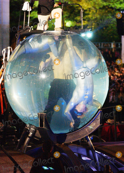 After Seven Photo - Photo by Walter Weissmanstarmaxinccom20065806David Blaine emerges from his Drowned Alive Tank after seven days submerged in water  He also attempted to hold his breath for nine minutes but came up just short of the record(Lincoln Center NYC)